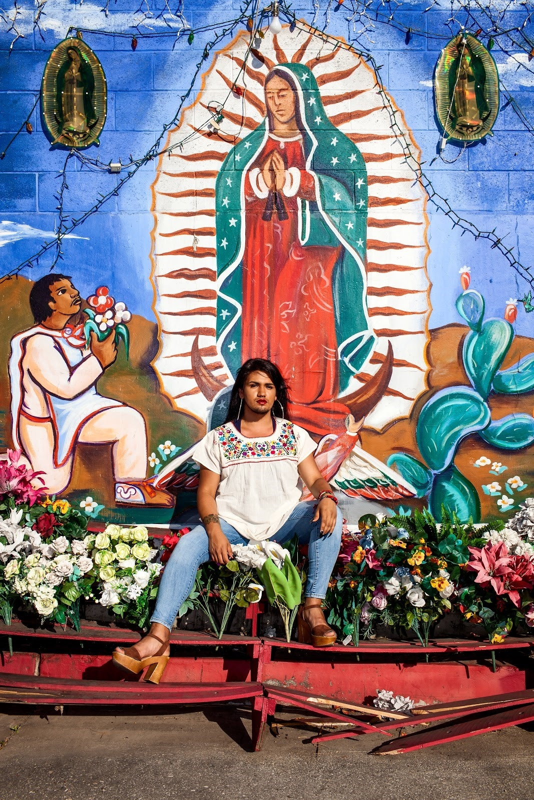 Image created by Eve Moreno in front of mural of the Virgen de Guadalupe appearing to Diego.