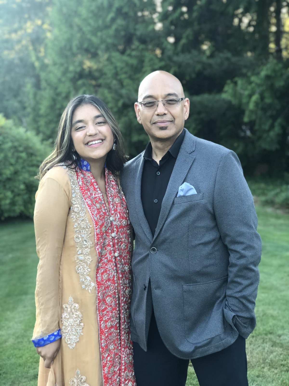 Aleena at a wedding with her father